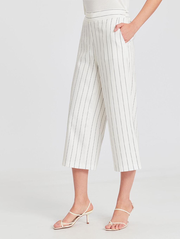 Kadın Bilek Boy Çizgili Geniş Paça Pantolon
