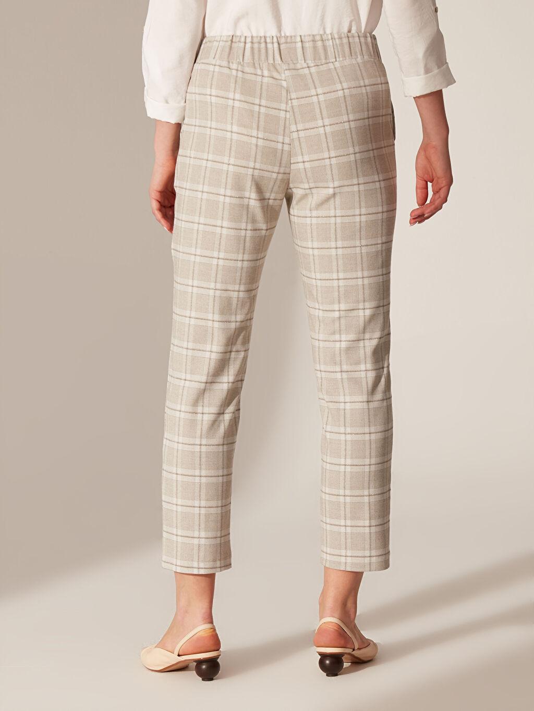 %64 Polyester %3 Elastan %32 Viskon %1 Metalik iplik Beli Lastikli Desenli Havuç Pantolon
