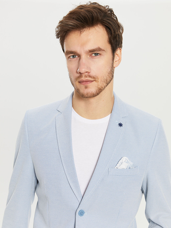 %59 Polyester %40 Viskoz %1 Elastan %100 Polyester  Dar Kalıp Dokulu Blazer Ceket
