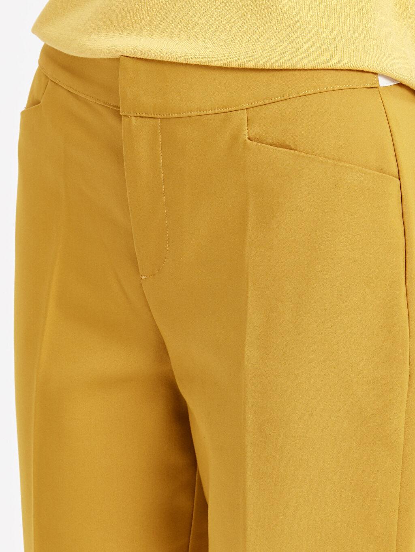 %49 Pamuk %47 Polyester %4 Elastan Beli Lastikli Düz Paça Kumaş Pantolon
