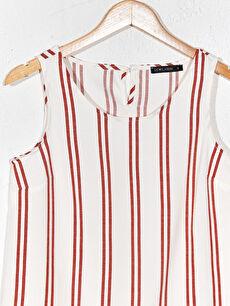 %44 Polyester %3 Elastan %53 Viskoz  Desenli Kolsuz Bluz