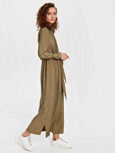 Dokulu Kumaştan Kuşaklı Uzun Elbise